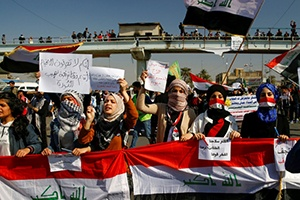 University students hold banners as they gather during ongoing anti-government protests in Baghdad, Iraq, Feb. 6, 2020